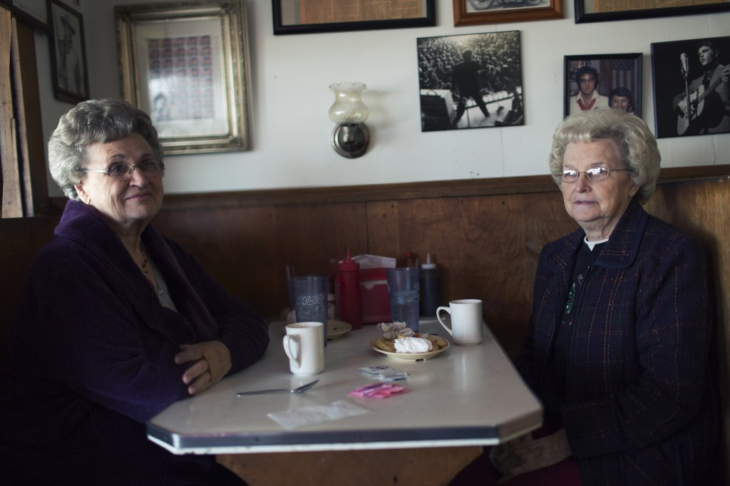 Two women sip coffee at Johnnie's Drive-Inn in Tupelo, Mississippi. They told Reynolds that they both grew up knowing Elvis Presley, who was born and raised in that Northeast Mississippi town. A handful of her photographs will be on exhibit at the Ogden Museum of Southern Art in New Orleans starting on Dec. 5.  Photo courtesy of Tamara Reynolds