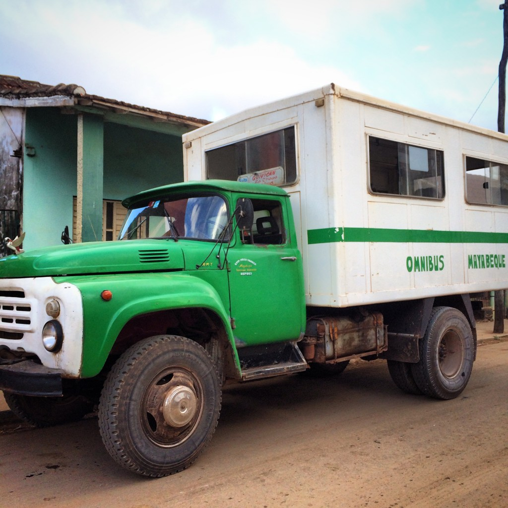 A truck with a box and seats mounted on the chassis, in La Salud, Cuba. Photo by Edel Rodriguez
