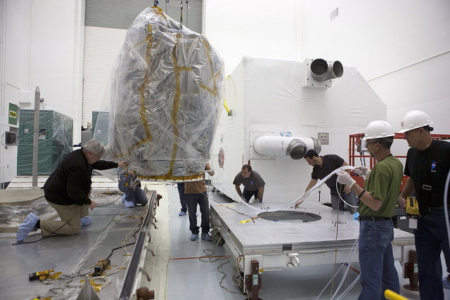 NOAA's Deep Space Climate Observatory spacecraft, or DSCOVR, comes out of storage more than a decade after the originally mission was put on hold. Photo by: NASA/Kim Shiflett