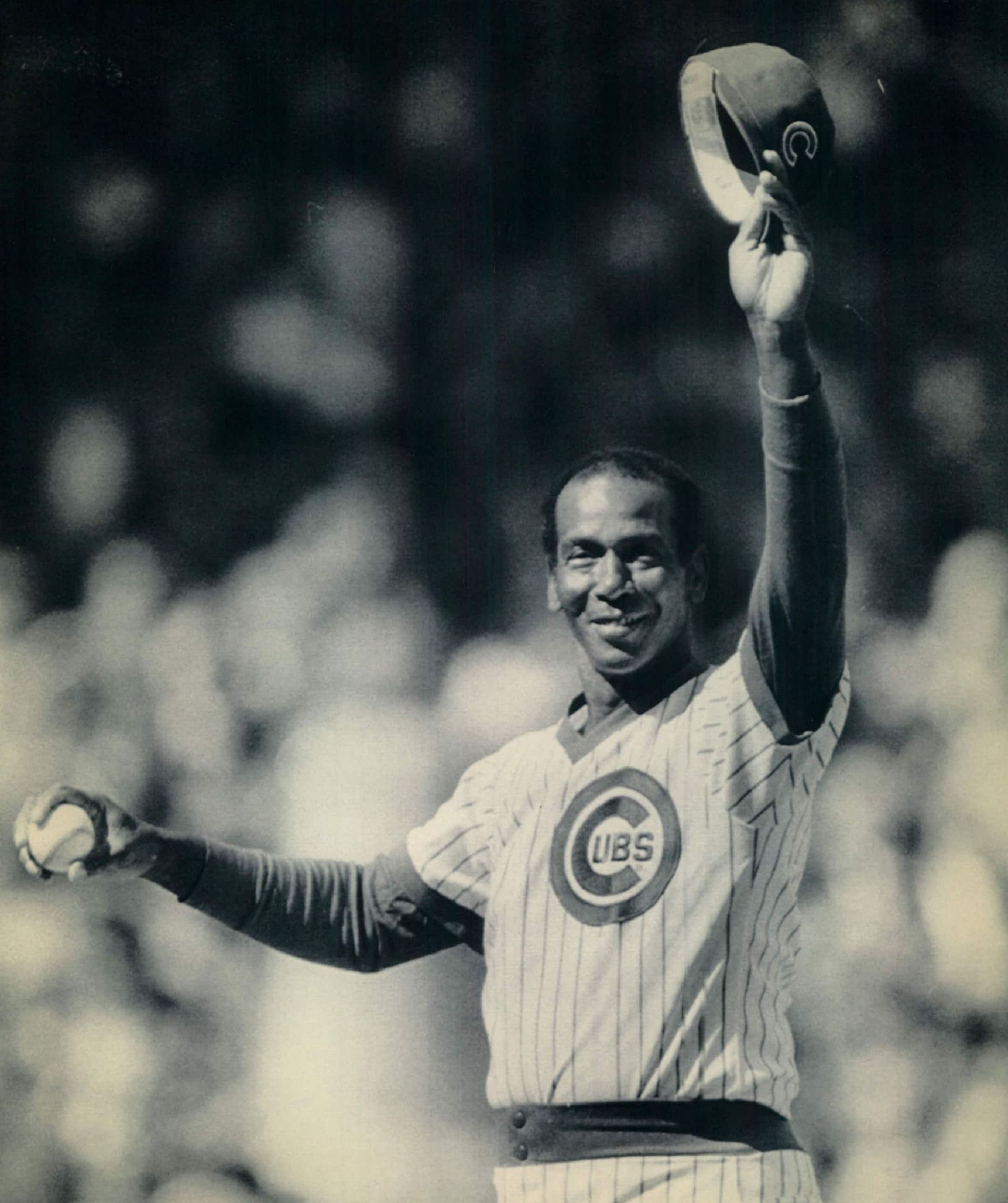 "OCT 2 1984, OCT 3 1984; Special for the Denver Post -- ""Mr. Cub"" Ernie Banks salutes the crowd at Wrigley Field before throwing out the first pitch for the Cubs-Padres playoff opener. 1984  (Photo By The Denver Post via Getty Images)"