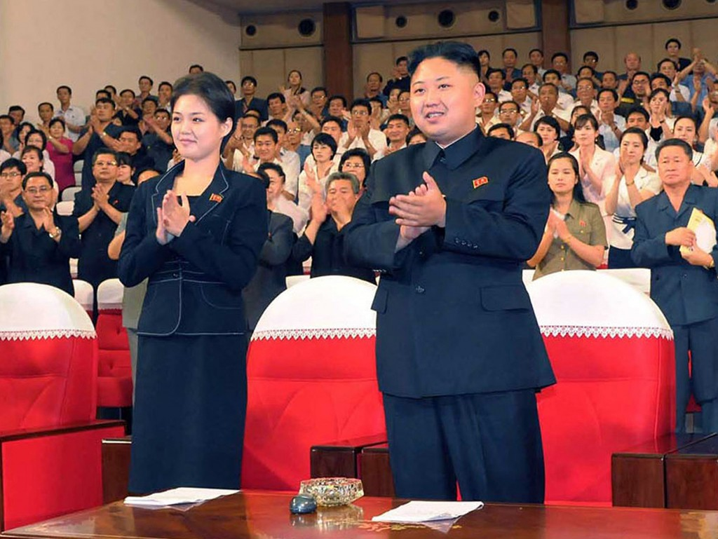 Korean Central News Agency released this photo on July 9 showing North Korean leader Kim Jong Un accompanied by a young unidentified woman at a band performance in Pyongyang. Credit: KNS/AFP/Getty Images