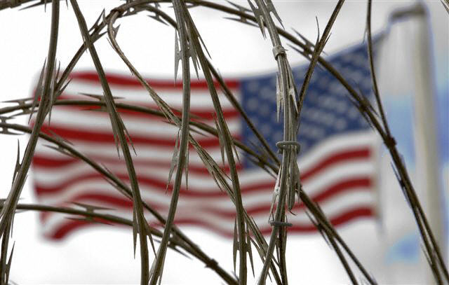 The US flag flies above the Camp Delta maximum security area in December 2006 on the US Naval Base at Guantanamo Bay, Cuba...
