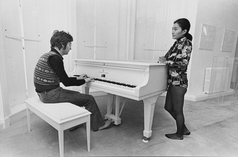 "Photo of John LENNON; with Yoko Ono, playing white grand piano at Tittenhurst home during making of the ""Imagine"" film. Photo by Tom Hanley/Redferns"