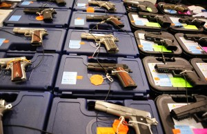 An assortment of Colt and Glock semi-automatic handguns are on display at the Nations Gunshow on November 21, 2009 in Chantilly, Virginia. Vendors and collectors of current and vintage arms and accessories have gathered to buy sell and trade during the three day event. AFP PHOTO/Karen BLEIER (Photo credit should read KAREN BLEIER/AFP/Getty Images)