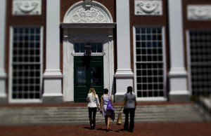 Students walk on campus at Harvard Business School. Photo by Brent Lewin/Bloomberg