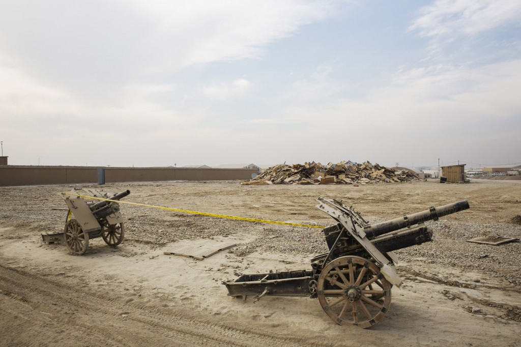 Russian guns are displayed in front of debris left over from temporary housing demolished during work to dismantle vast swaths of the massive Bagram Air Field in the Parwan province of Afghanistan on Jan. 2, 2015. Photo by Lucas Jackson/Reuters