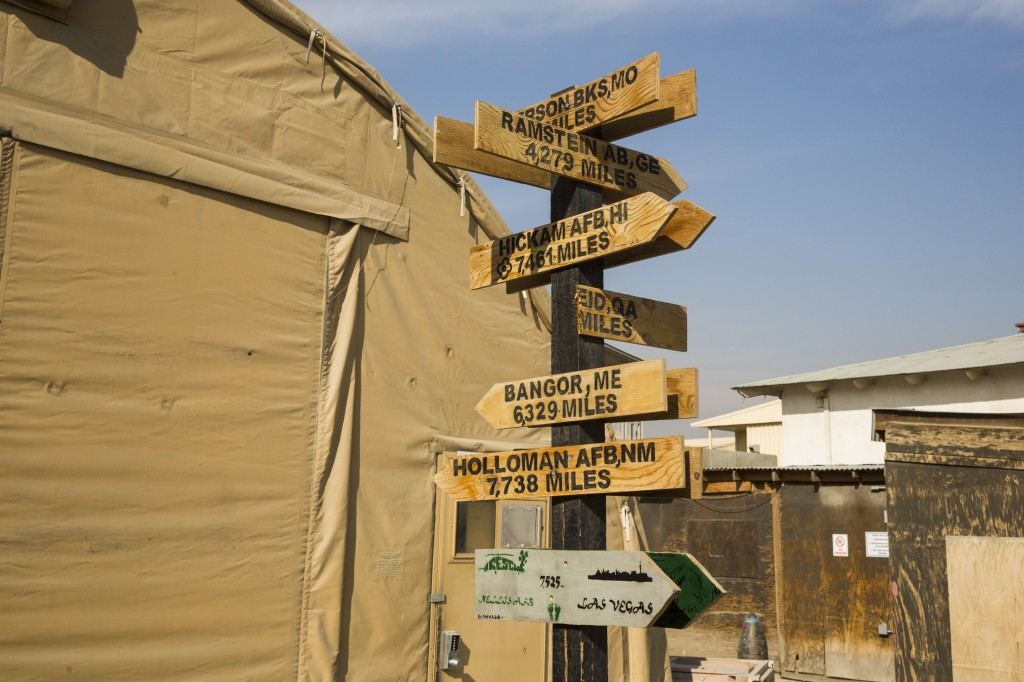 Sign posts declaring the distance from Bagram Air Field to various U.S. bases across the world are seen on the base in the Parwan province of Afghanistan on Jan. 2, 2015. Photo by Lucas Jackson/Reuters
