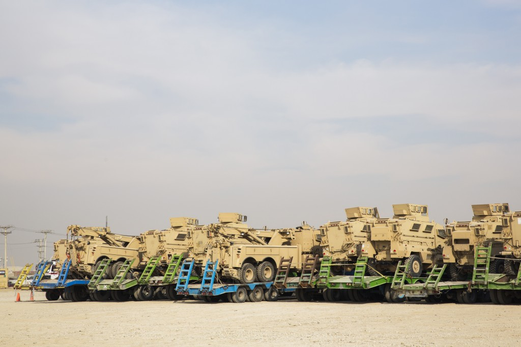 U.S. Army MRAP vehicles stand loaded onto local trucks before being shipped to Kuwait during work to shrink Bagram Air Field in the Parwan province of Afghanistan Jan. 2, 2015. Photo by Lucas Jackson/Reuters