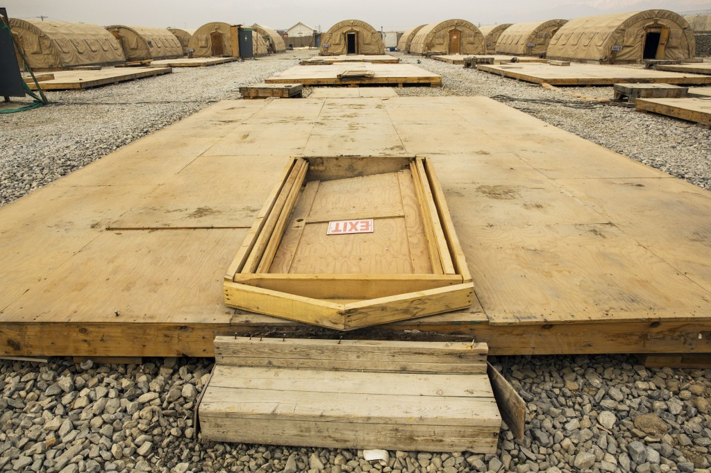 A door rests on the floor of a tent that has been dismantled as part of areas being demolished on the massive Bagram Air Field in the Parwan province of Afghanistan on Jan. 2, 2015. Photo by Lucas Jackson/Reuters