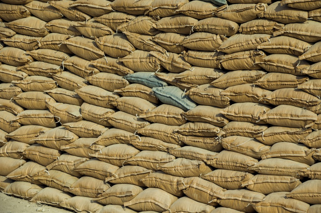A view of sand bags filled with earth stand stacked around concrete shelters to protect from mortars and rockets inside of Bagram Air Field in the Parwan province of Afghanistan on Jan. 2, 2015. Photo by Lucas Jackson/Reuters