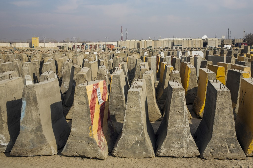 A stack of concrete barriers are stored in a yard after being removed during work to dismantle vast swaths of the massive Bagram Air Field in the Parwan province of Afghanistan on Jan. 2, 2015. Photo by Lucas Jackson/Reuters