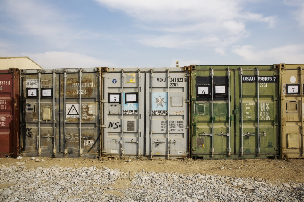 Shipping containers waiting to be either shipped back to the United States or disposed of stand stacked inside of Bagram Air Field in the Parwan province of Afghanistan Jan. 2, 2015. Photo by Lucas Jackson/Reuters