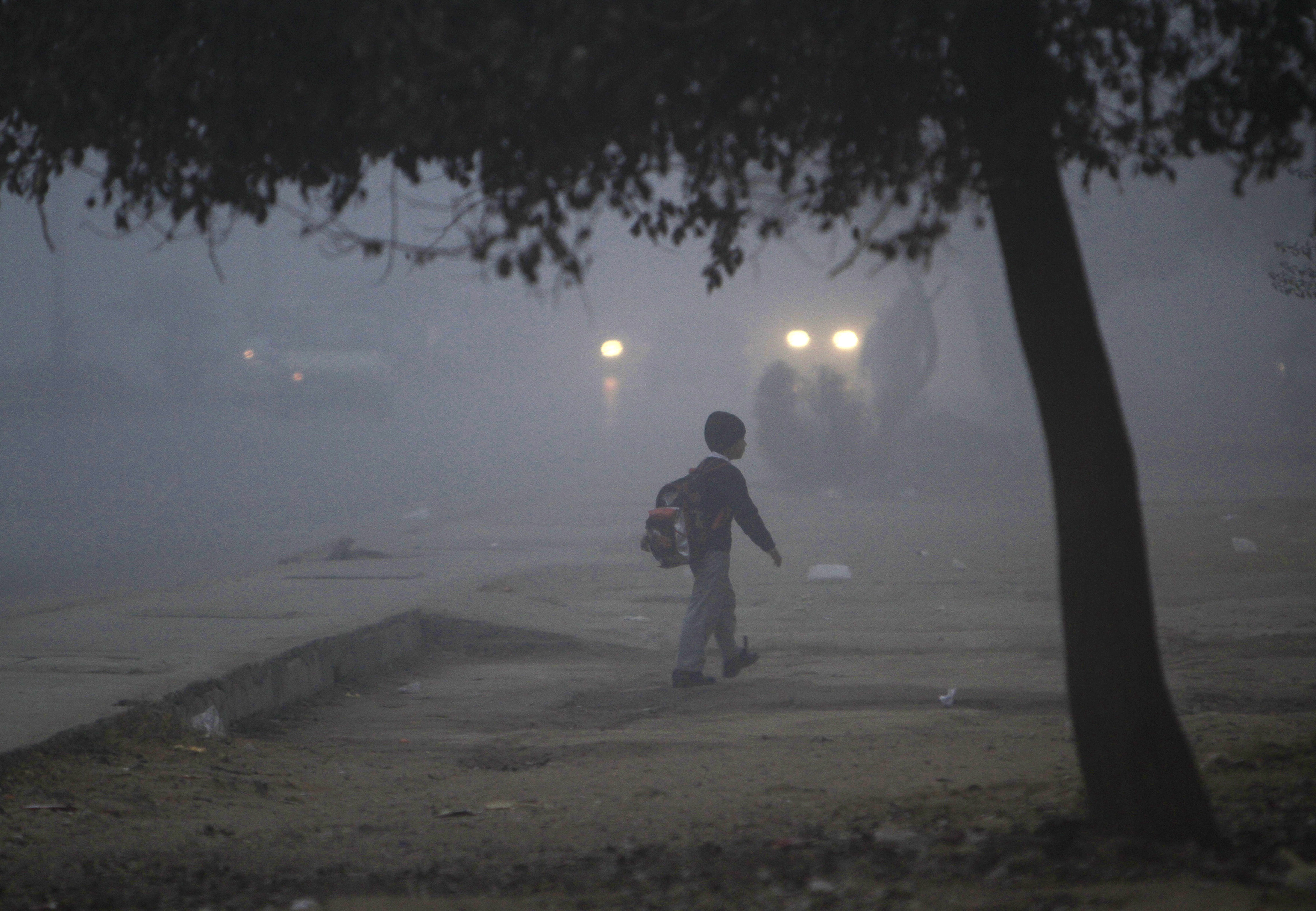A boy walks in fog while heading to school after it reopened in Rawalpindi January 12, 2015. Photo by Faisal Mahmood/Reuters