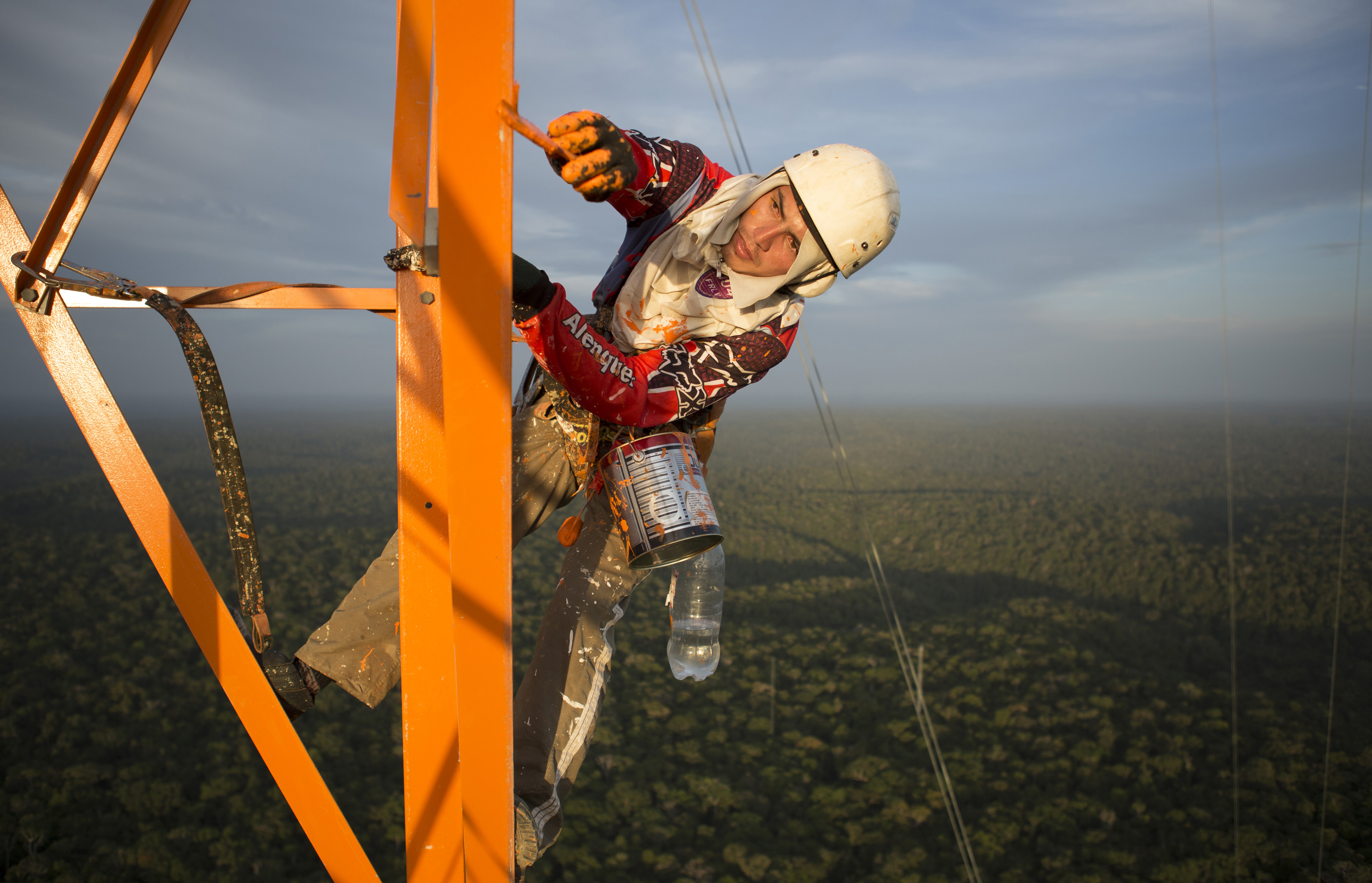 A worker paints the Amazon Tall Tower Observatory (ATTO) in Sao Sebastiao do Uatuma in the middle of the Amazon forest in Amazonas state January 10, 2015. Photo by Bruno Kelly/Reuters