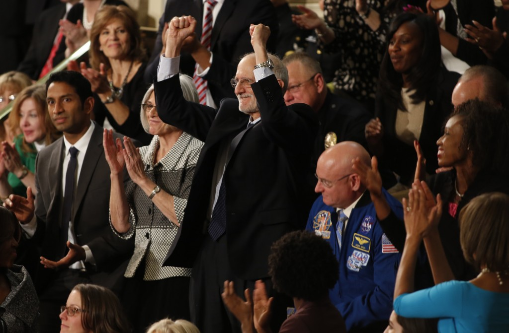 Alan Gross, recently released from prison in Cuba, thrusts his fists in the air as he is mentioned by President Barack Obama during his State of the Union address Tuesday night. Photo by Larry Downing/Reuters