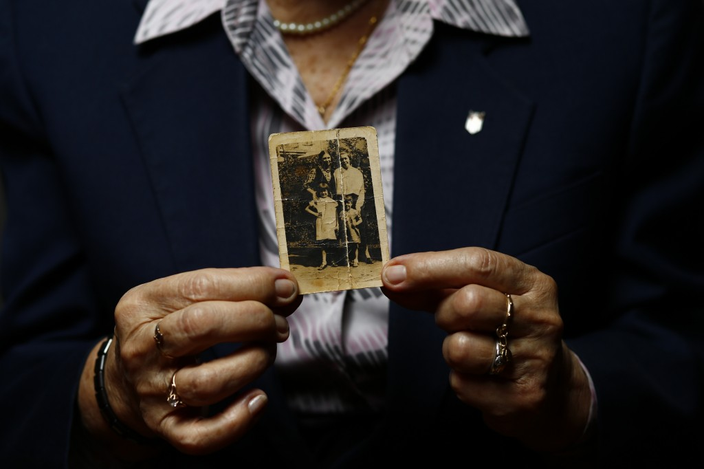 Auschwitz concentration camp survivor Maria Stroinska poses for a portrait in Warsaw