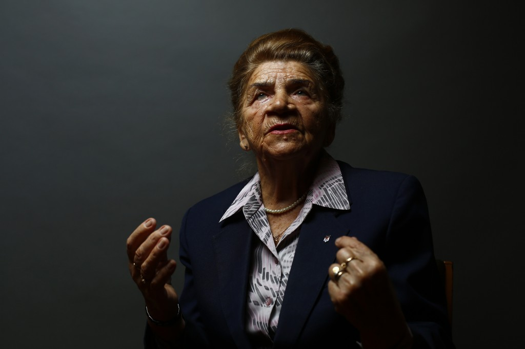 Auschwitz death camp survivor Maria Stroinska gestures as she poses for a portrait in Warsaw