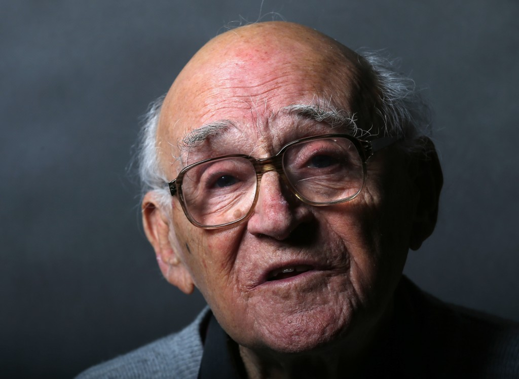 Auschwitz death camp survivor Laszlo Bernath poses for a portrait in Budapest
