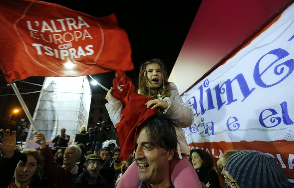 Supporters of opposition leader and head of leftist Syriza party Alexis Tsipras cheer at exit poll results in Athens, Jan. 25, 2015. Photo by Marko Djurica REUTERS.