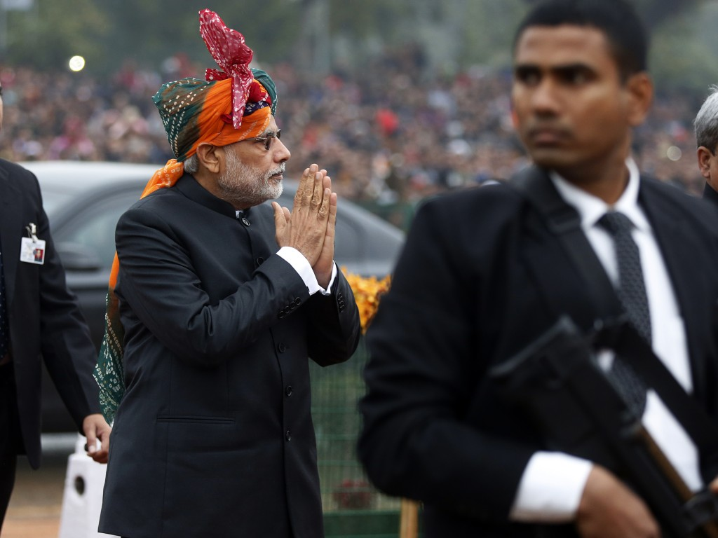 India's Prime Minister Narendra Modi gestures to the crowd as he arrives at the Republic Day parade in New Delhi. Photo by Jim Bourg/Reuters