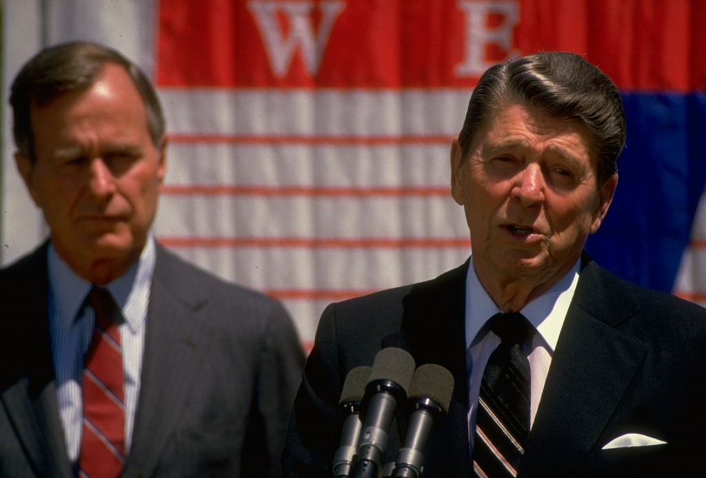 President Ronald Reagan (left) speaks at the White House with Vice President George H.W. Bush at his side. Photo by Diana Walker/Time Life Pictures/Getty Images