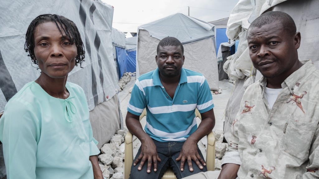 Tens of thousands of earthquake survivors remain in tent camps like Camp Immaculée, located in Port-au-Prince. AJWS said the camp's residents face imminent eviction, and most have nowhere to go next. Centered is Jackson Doliscar, who, at the time, represented FRAKKA (Force for Reflection and Action on Housing), an organization that acted as advocates on behalf of earthquake survivors, providing legal aid and calling for a more sustainable plan to resettle displaced persons. Doliscar is flanked by camp committee members who, at every one of these camps, help promote the rights of the people living in these camps, AJWS said. Photo by Ed Kashi/American Jewish World Service