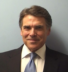 Texas Gov. Rick Perry poses for a mug shot after turning himself in to authorities in August in Austin, Texas. Photo by Travis County Sheriff's Office