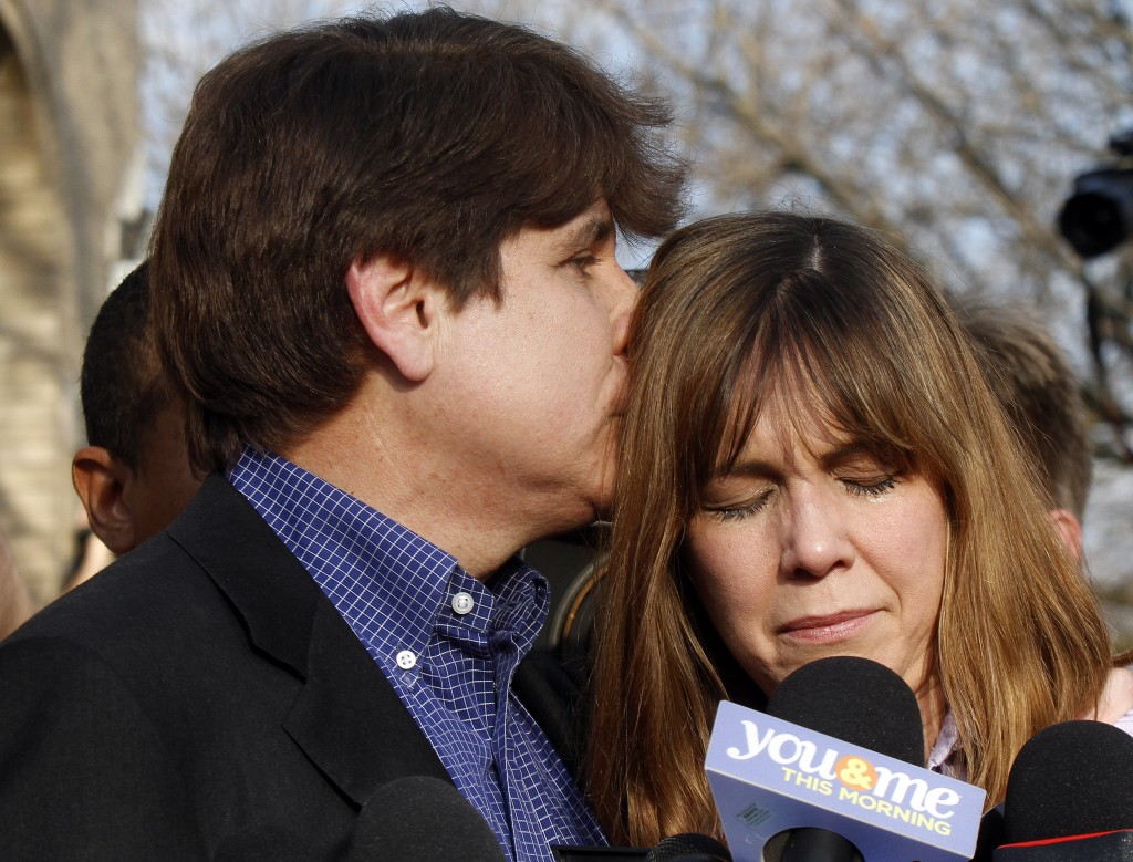 Disgraced former Illinois Governor Rod Blagojevich kisses his wife Patti during a news conference outside his home on March 14, 2012. Photo by Frank Polich/Getty Images