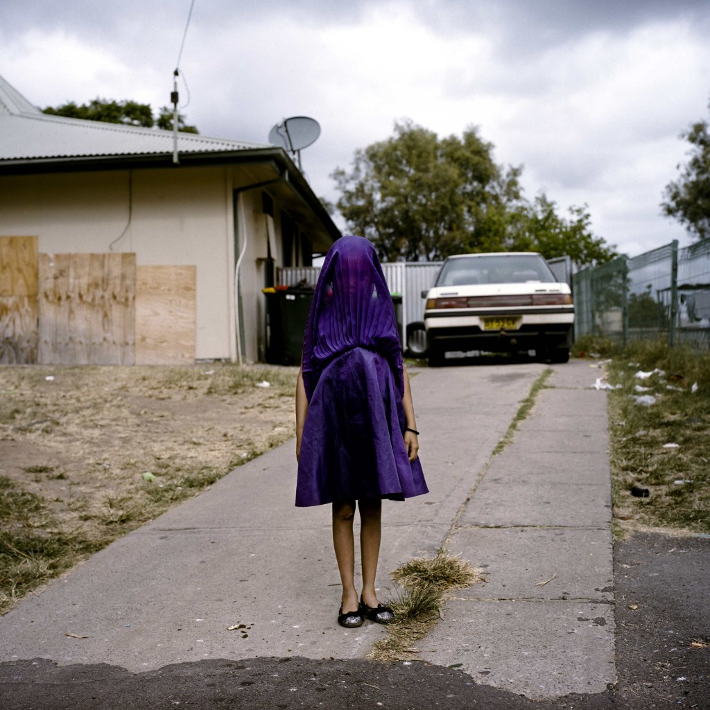 Raphaela Rosella, an Australian photographer of Oculi agency, won the First Prize in the Portraits Category, Singles, of the 2015 World Press Photo contest with this portrait of Laurinda waiting in her purple dress for the bus that will take her to Sunday school in Moree, New South Wales, Australia, in this picture released by the World Press Photo organisation on February 12, 2015. Photo by Raphaela Rosella