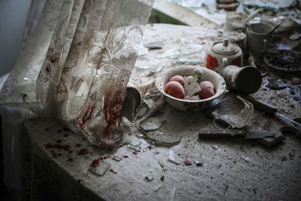 Sergei Ilnitsky, a Russian photographer of the European Pressphoto Agency, won the First Prize in the General News Category, Singles, of the 2015 World Press Photo contest with this image of damaged goods lying in a kitchen in downtown Donetsk, in this picture taken August 26, 2014 and released by the World Press Photo on February 12, 2015. Photo by Sergei Ilnitsky