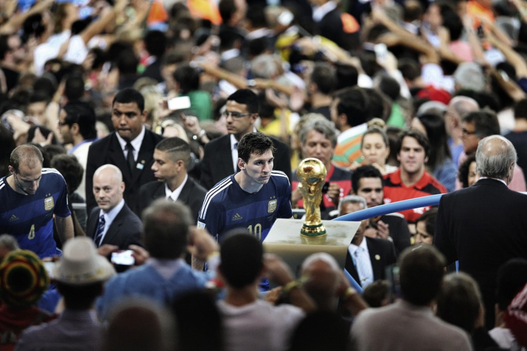 Bao Tailiang, a Chinese photographer of Chengdu Economic Daily, won the First Prize in the Sports Category, Singles, of the 2015 World Press Photo contest with this picture of Argentina's player Lionel Messi coming to face with the World Cup trophy during the final celebrations at Maracana Stadium in Rio de Janeiro, in this picture taken July 13, 2014. Photo by Bao Tailiang