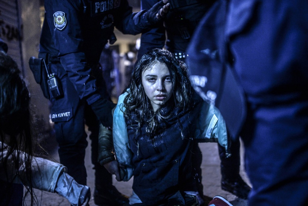 Bulent Kilic, a Turkish photographer for Agence France-Presse, won the First Prize in the Spot News Category, Singles, of the 2015 World Press Photo contest with this picture of a young girl after she was wounded during clashes between riot police and protesters following the funeral of Berkin Elvan, the 15-year-old boy who died from injuries suffered during last year's anti-government protests in Istanbul, in this picture taken March 12, 2014. Photo by Bulent Kilic