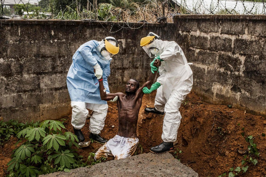 Pete Muller, a U.S. photographer of Prime on assignment for National Geographic/The Washington Post, won the First Prize in the General News Category, Stories, of the 2015 World Press Photo contest with his series of pictures which includes this one of medical staff at the Hastings Ebola Treatment Center escorting a man in the throes of Ebola-induced delirium back into the isolation ward from which he escaped, in Freetown, in this picture taken November 23, 2014. Photo by Pete Muller
