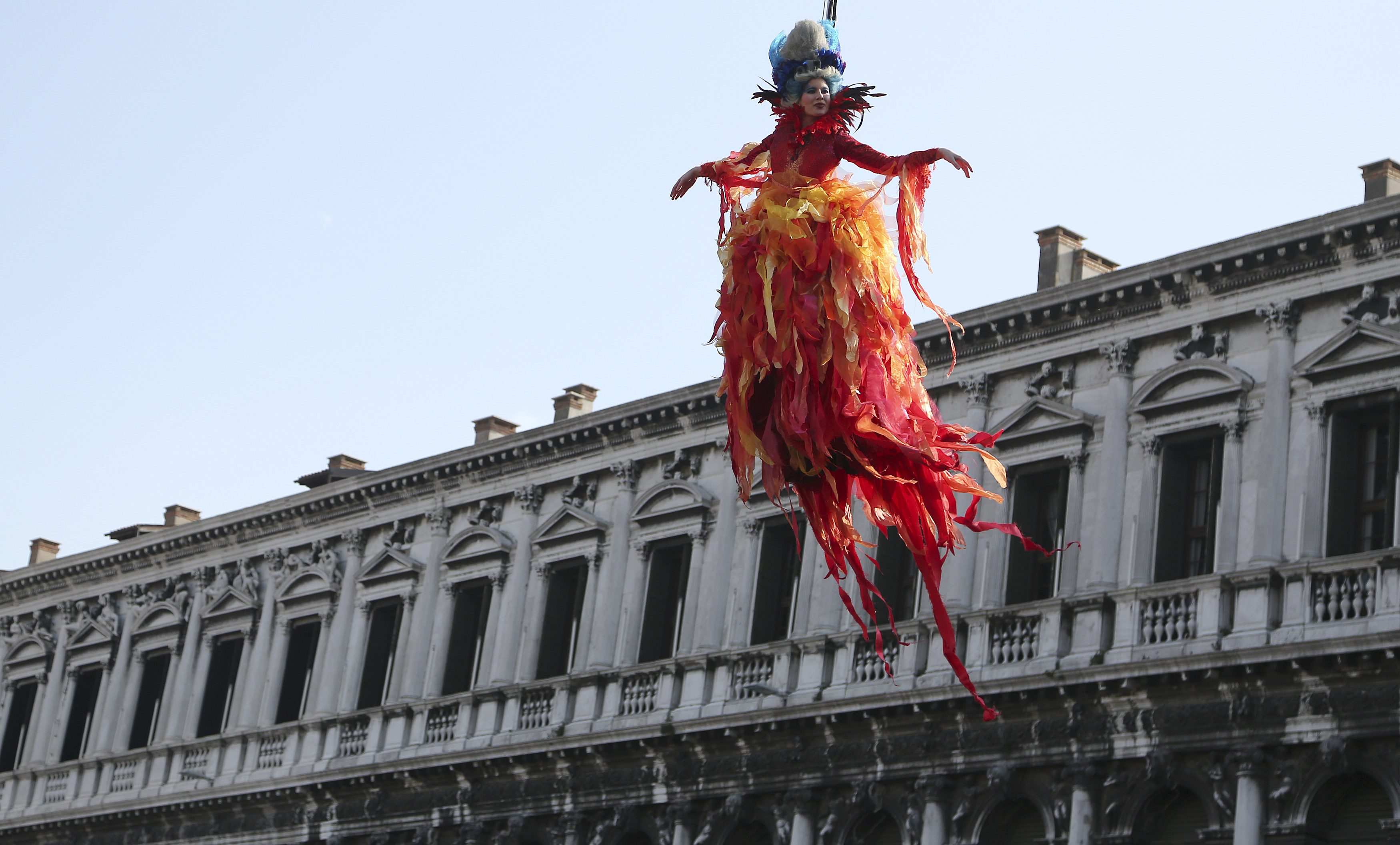 The traditional Columbine descends from Saint Mark's tower bell on an iron cable during the Venetian Carnival in Venice February 8, 2015. Photo by Stefano Rellandini/REUTERS.