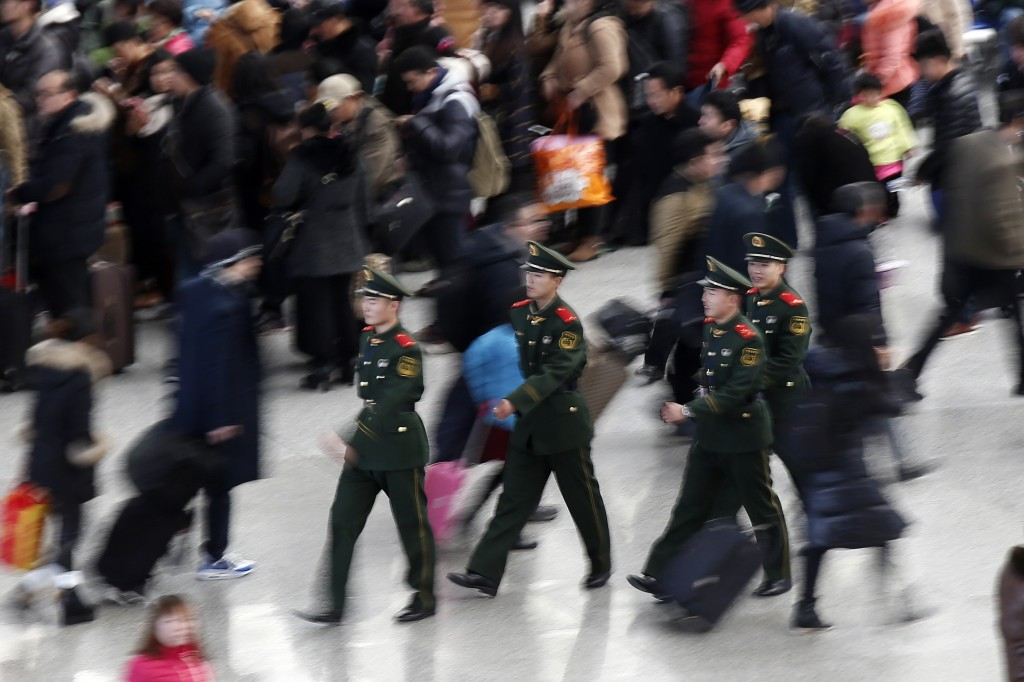 Paramilitary police officers walk at Hongqiao train station in Shanghai, ahead of Chinese New Year, Feb. 9. Chinese Ministry of Transport said a total of 2.807 billion trips are expected to be made during the 40-day Spring Festival travel rush, which began on Feb. 4 and will last until March 16, Xinhua News Agency reports. Photo by Aly Song/Reuters