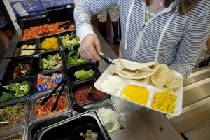 Students at Doherty Middle School get their healthy lunch at the school cafeteria in Andover, Massachusetts. Photo by Melanie Stetson Freeman/The Christian Science Monitor via Getty Images