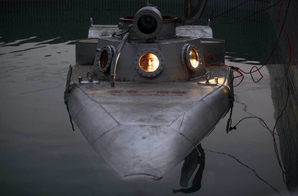 Farmer Zhang Wuyi, 37, tests the double-seater submarine that he built in a shipyard in Wuhan, Hubei province. Avid about science and inventions, Zhang has worked with engineers to construct six tiny submarines, selling one to a businessman for nearly $16,000. The submarines, mainly designed for harvesting aquatic products, such as sea cucumber, have a diving depth of 20-30 metres, and can travel for 10 hours, Chinese media reported. Photo by Reuters/Stringer.
