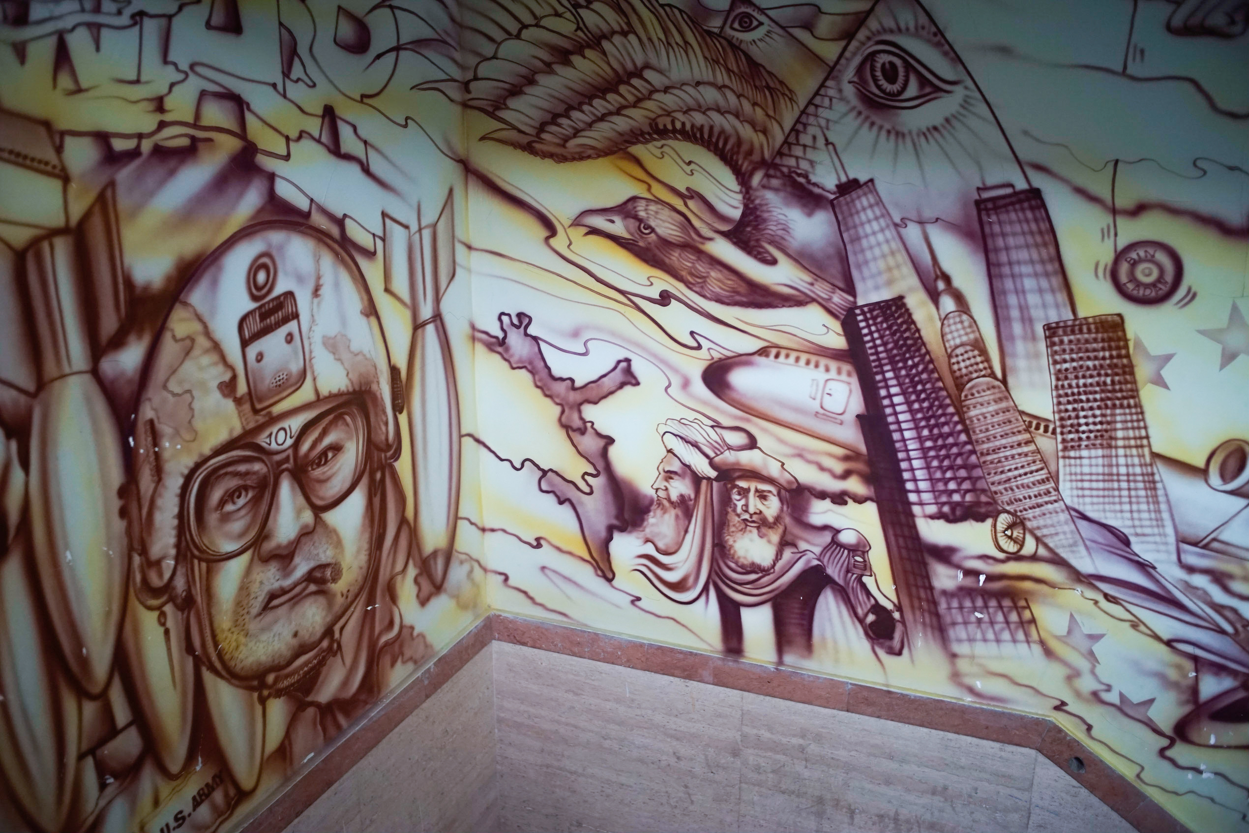 More detail of the murals leading up to the museum floor, including one which portrays a part of the conspiracy theory that 9/11 was engineered by the U.S. and Israel to help justify invading the Middle East. (Our tour guide affirmed his belief in this conspiracy, along with several others.)