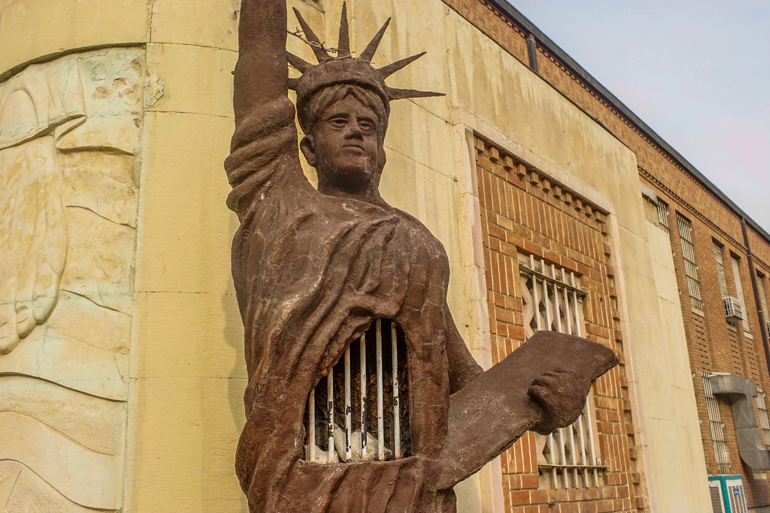 The second anti-American statue outside the main entrance. Here, the Statue of Liberty's gown opens to reveal two imprisoned white birds.