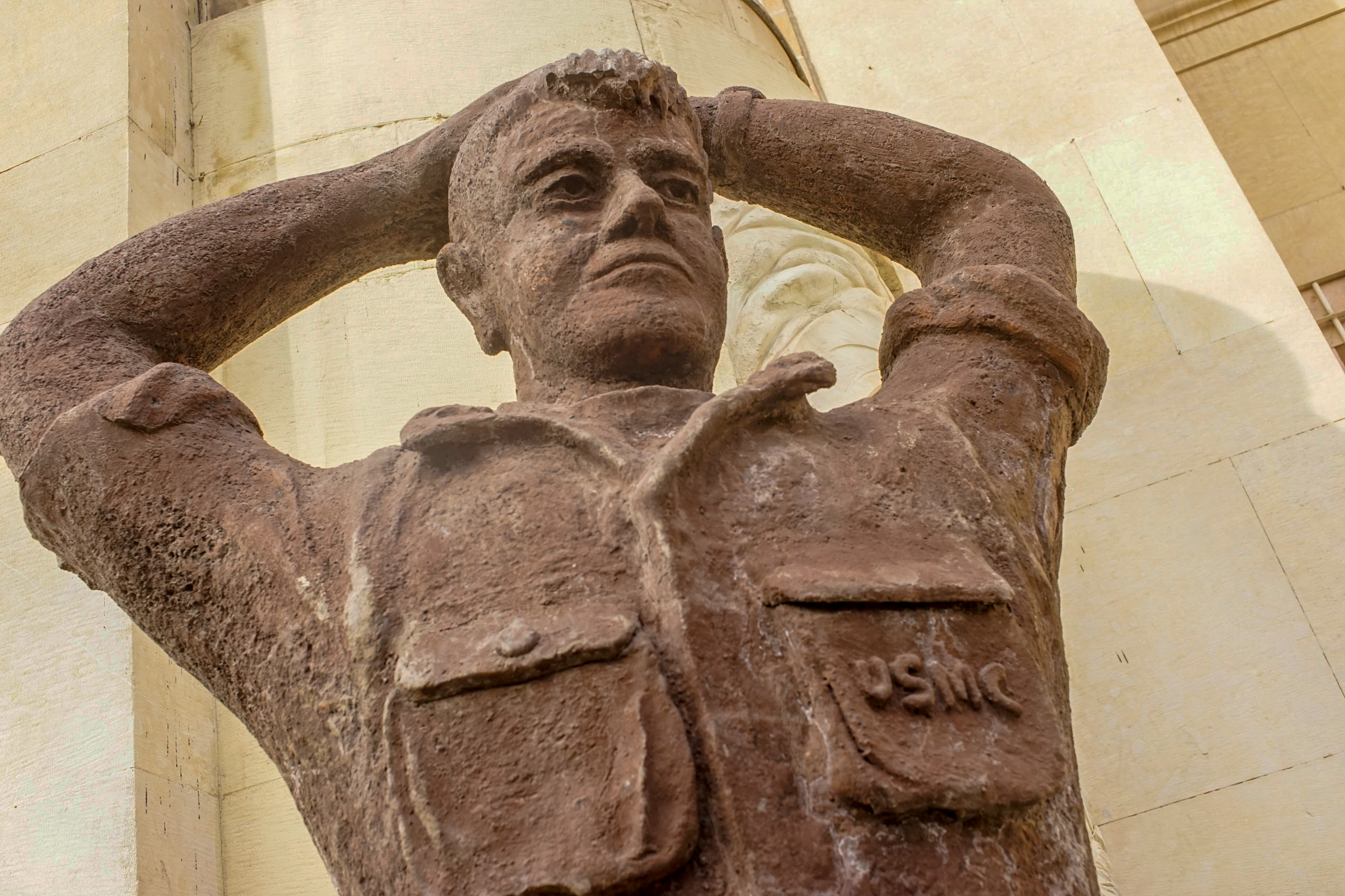 One of two plaster statues outside the main embassy building.  This one of a U.S. Marine seems to be copying the image of captured Marine Corporal Steve Kirtley, who was one of the Marines stationed at the embassy in 1979, and was photographed with other hostages.