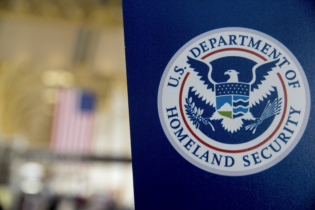 File photo of Department of Homeland Security sign at Ronald Reagan National Airport in Washington, D.C. Photo by Andrew Harrer/Bloomberg via Getty Images