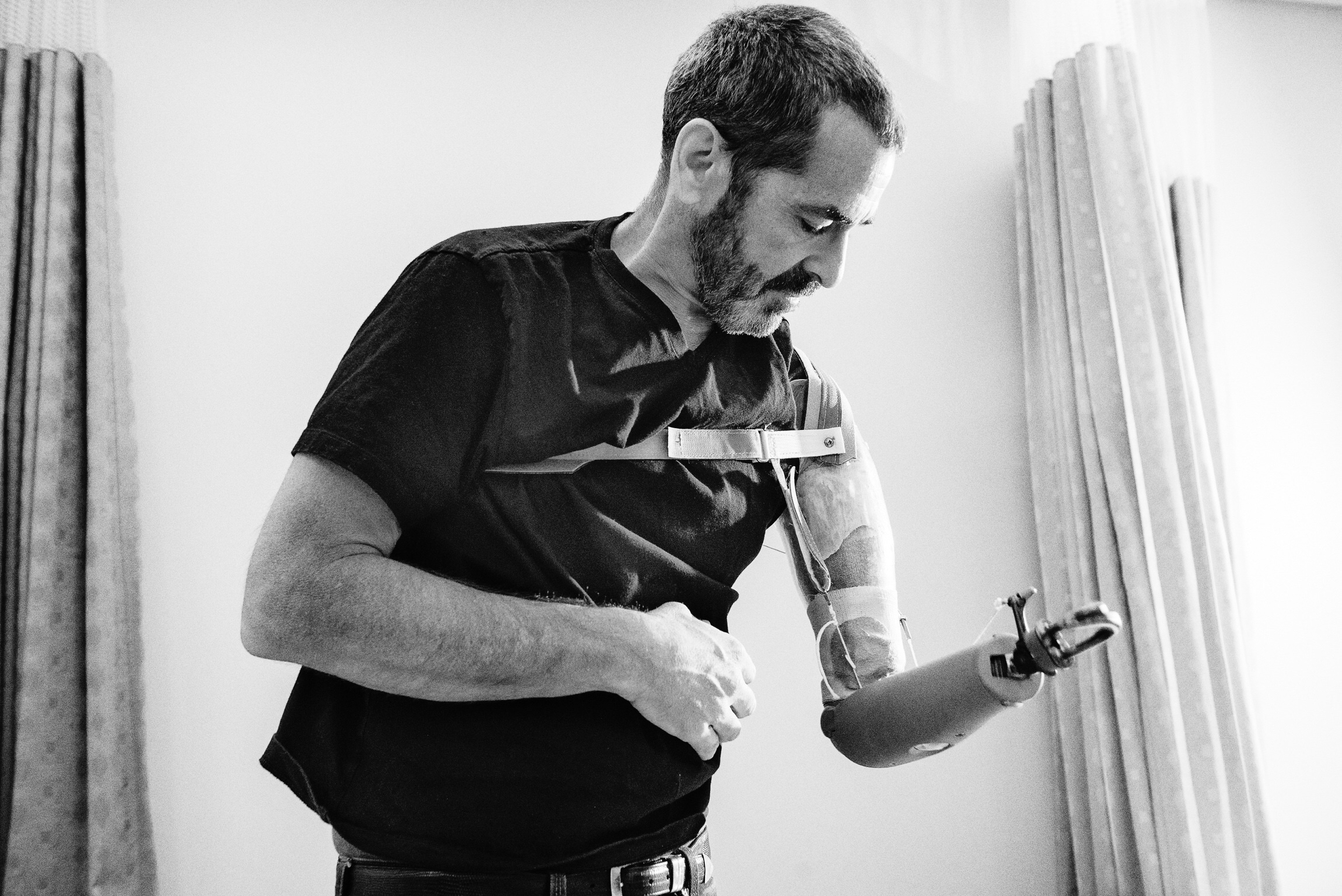 Miles operating his body powered prosthetic at the Medstar National Rehabilitation Hospital in Washington. The technology is not state-of-the-art, but the device is very rugged and reliable. Photo by Chris Anderson