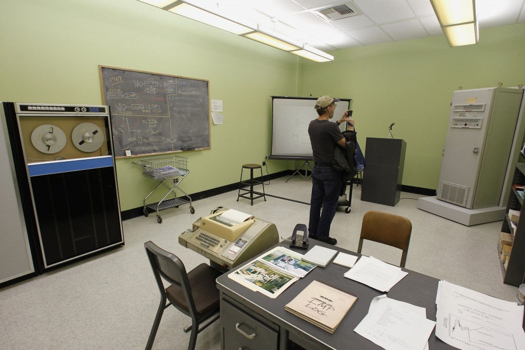 A visitor attends the grand opening of the Kleinrock Internet Heritage Site and Archive in 3420 Boelter Hall, the birthplace of the Internet at UCLA in Los Angeles. The recreated lab features a replica of the Sigma 7 computer, left, a teletype, center, similar to one used to communicate with the SIGMA 7 computer, which was connected to UCLA's Interface Message Processor, right. Photo by Fred Prouser/Reuters