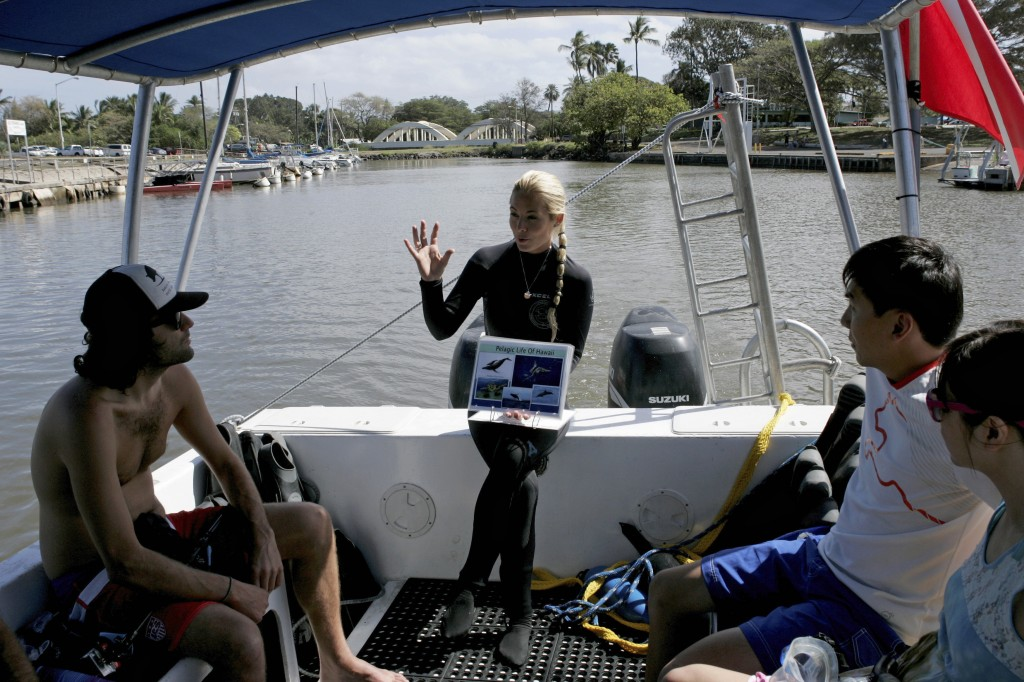 Shark ecologist Ocean Ramsey gives a pre-dive briefing before taking tourist on a cageless shark dive tour in Haleiwa, Hawaii February 16, 2015. Photo by Hugh Gentry/Reuters