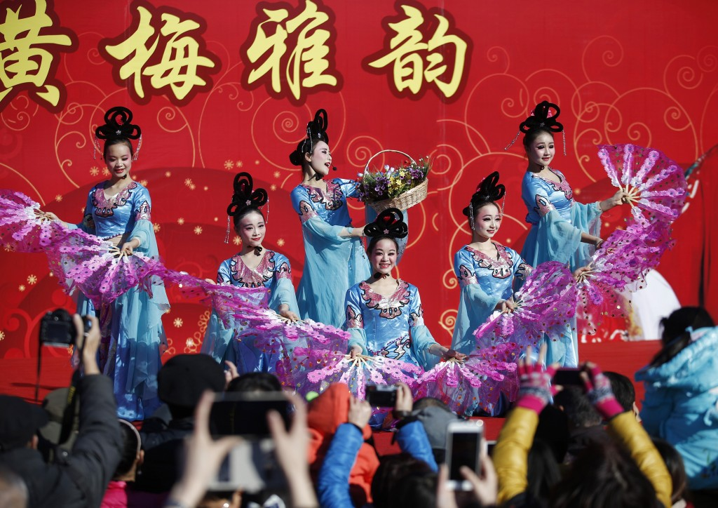 Traditional dancers perform at the Temple Fair, part of Chinese New Year celebrations at Ditan Park, also known as the Temple of Earth, in Beijing, Wednesday. Photo by Kim Kyung-Hoon/Reuters