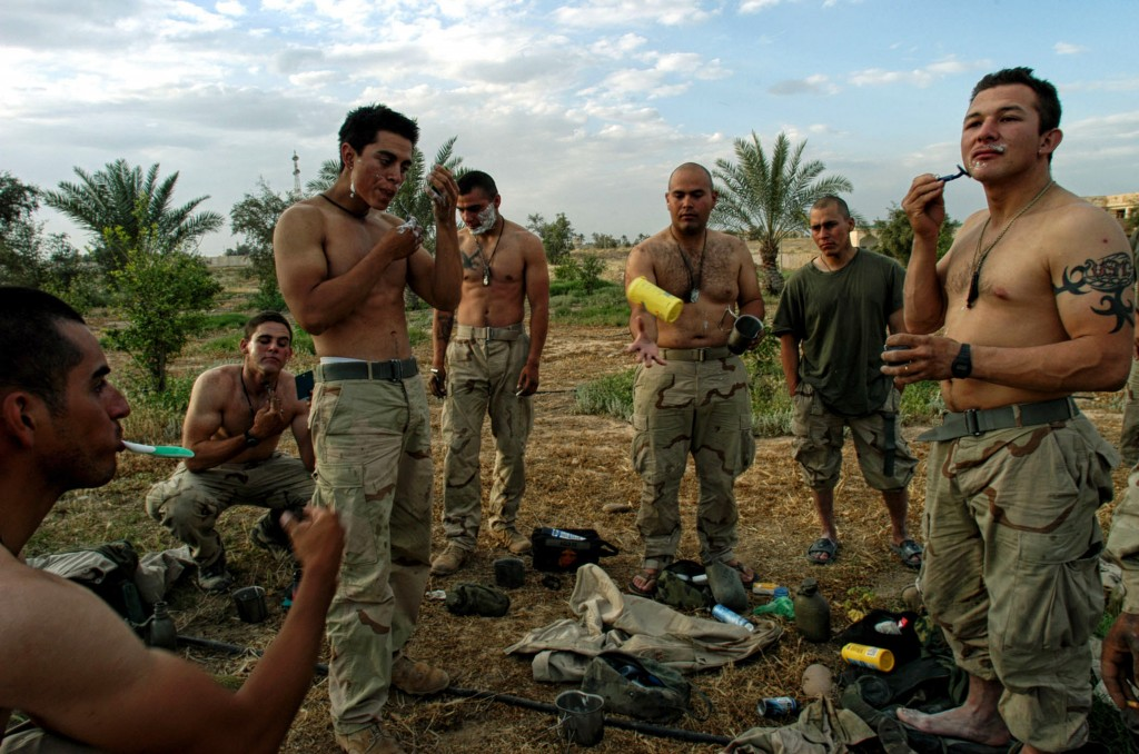 United States Marines take a break to shave in front of one of Saddam Hussein's presidential palaces the day Tikrit fell from Republican Guard rule in Iraq, April 15, 2003. Photo by Lynsey Addario/ Corbis