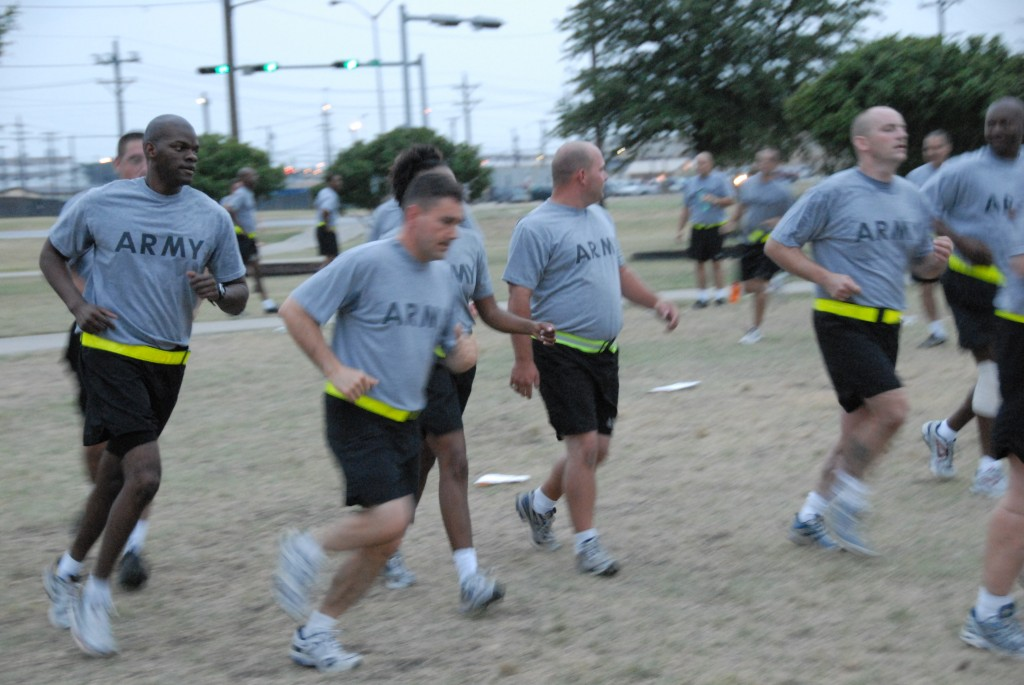 Jogging Wounded soldiers and Fort Hood staff participate in the morning routine.