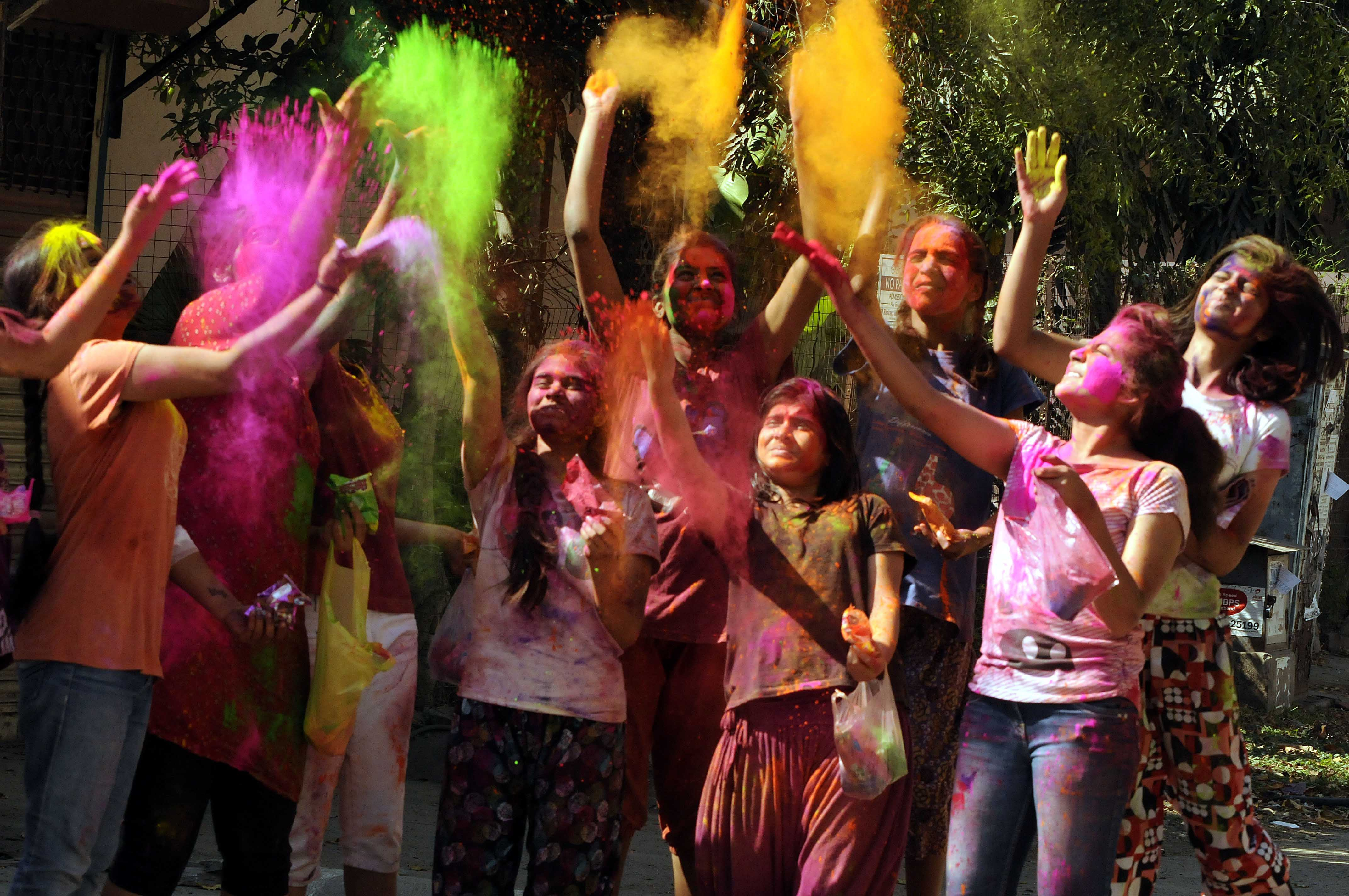 Children play with colors on the occasion of Holi 'The Festival of Colours,' on March 6, 2015 in Indore, India.  Photo by Arun Mondhe/Hindustan Times via Getty Images.