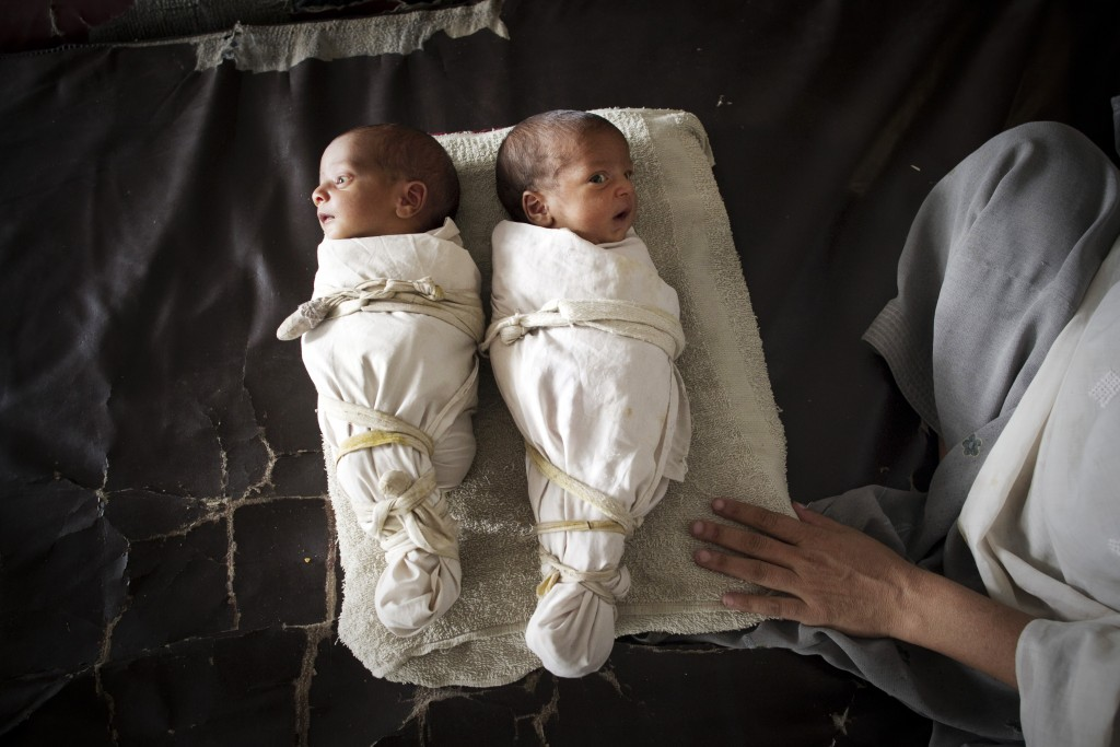 Newborn Babies Twins born in a field hospital after flooding began. AFP/Getty Images