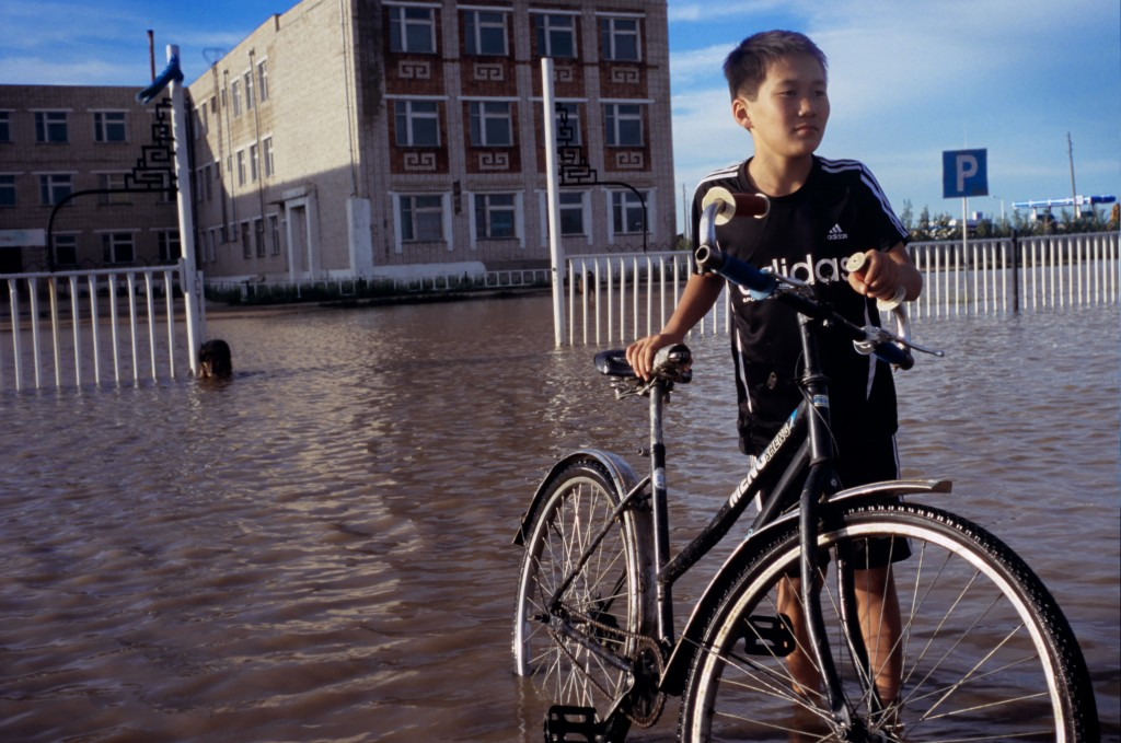 Seasonal flooding A young boy wheels his bike through heavy flood waters near Ulaanbaatar, the capital of Mongolia. Photo by Aletheia Casey/Getty Images